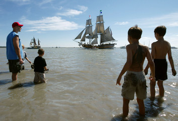 PEOPLE WATCH AS BRIGATINE PASSES DURING TALL SHIPS FESTIVAL IN RICHMONDBRITISH COLUMBIA.