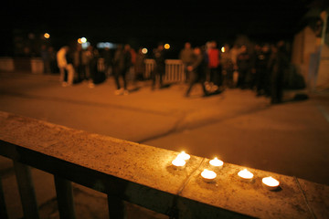 Candles are lit in memory of the victims at the entrance of the coal mine area where a mining accident occurred in Petrila