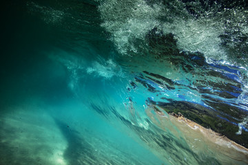 Underwater view from rolling ocean wave inside