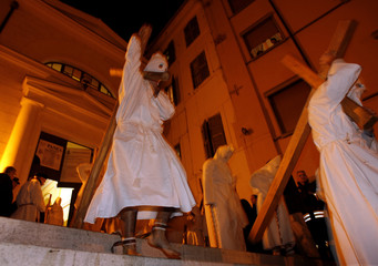 Penitents take part in a Good Friday procession in Civitavecchia during Holy Week in Italy