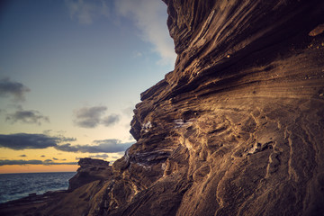 Rocky coastline with sunrise sky background
