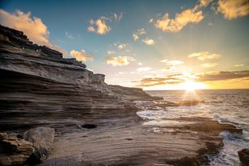 Sunrise in rocky coastline with ocean view