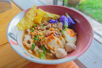 Noodle sukhothai with spicy soup in vintage bowl.