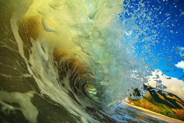 Ocean splashed wave in rip curl shape. Surfing sport activity in tropical water