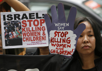 A protester holds a placard during a protest against Israel's attacks on Gaza, near the Israeli embassy in Makati City