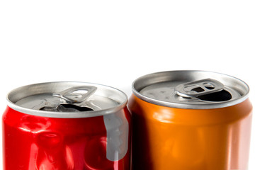 Various cans of soda on a white background