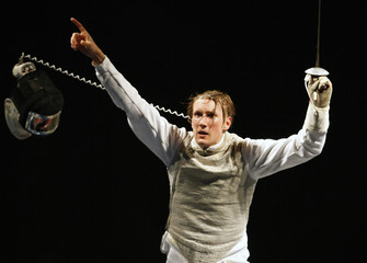 Kleibrink of Germany celebrates his victory against Ota of Japan during their men's individual foil fencing final at the Beijing 2008 Olympic Games