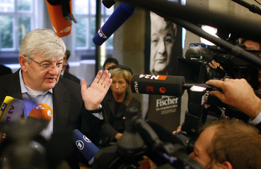 "Former German Foreign Minister Fischer gives intervieews after a news conference to present his new book ""Die rot-gruenen Jahre"" (the red-green years) in Berlin"
