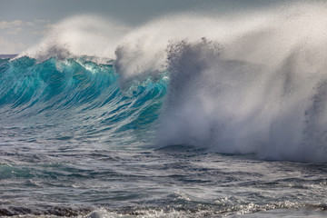 Blue shorebreak storming wave. Pacific ocean seascape water pattern