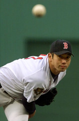 RED SOX HIDEO NOMO WATCHES HIS PITCH FLY TO THE PLATE.