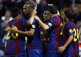 Barcelona's Henry celebrates with his team mates after scoring against Dundee United during their soccer match in Dundee, Scotland