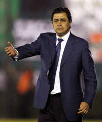 Tena, head coach of Mexico's America, gestures during soccer match against Argentina's Banfield in Buenos Aires