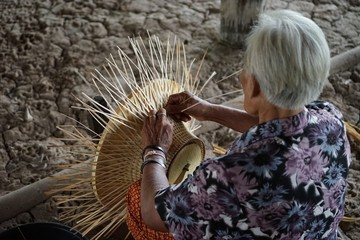 Young people wear hats made from natural materials, as well as crafts of local people in Asia.