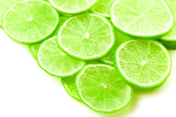 slices of lime on a white background