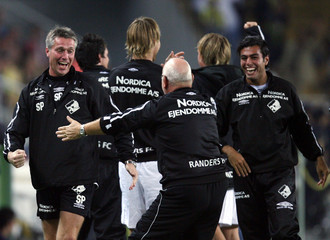 Randers FC staff and bench members celebrate their goal against Fenerbahce during their UEFA Cup first round soccer match in Istanbul