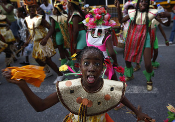 """Children dance to the """"socca"""" music as they perform during a children Carnival parade in Port-of-Spain"""