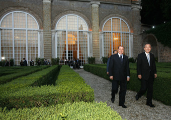 Italy's Prime Minister Berlusconi and United Nations Secretary General Ban arrive for news conference at Villa Madama in Rome