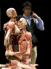 German anatomy professor von Hagens talks about two plastinated human specimens in love-making posture during the exhibit's unveiling in Berlin