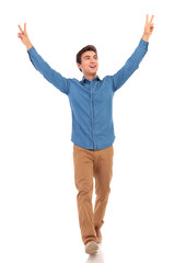 man looks to side walking with hands up