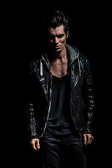 dramatic portrait of a young man in leather jacket