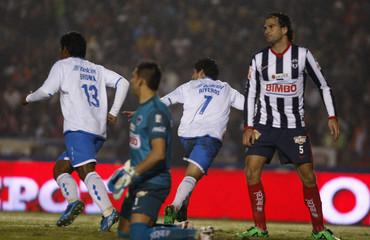 Cruz Azul's Riveros celebrates his second goal against Monterrey during their Mexican league championship soccer match final first leg in Monterrey