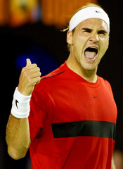 FEDERER OF SWITZERLAND CELEBRATES HIS WIN AT THE AUSTRALIAN OPEN IN MELBOURNE.
