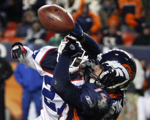 Denver Broncos wide receiver Stokley has the ball batted away in the endzone by Buffalo Bills cornerback Corner to secure the win for the Bills during their NFL football game in Denver