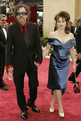 Director Burton and British actress Carter arrive at the 78th annual Academy Awards