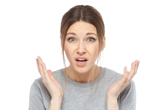 Closeup of puzzled unhappy woman isolated on white background showing negative emotions, looking helpless and disoriented, throwing her hands up as if asking what she can do about her trouble.