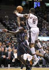 New Jersey Nets Williams tries to block a layup by Charlotte Bobcats guard Jackson in the fourth quarter of their NBA basketball game in East Rutherford
