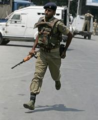Indian policemen runs after shootout in Srinagar