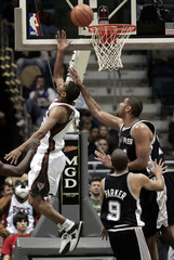 Spurs center Duncan fouls Bucks guard Bell's shot in the third quarter during NBA action in Milwaukee