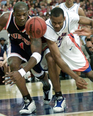 FLORIDA COLAS BATTLES WITH AUBURN KILLINGSWORTH FOR LOOSE BALL IN SECTOURNAMENT IN ATLANTA.
