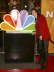 Steve Valentine kisses NBC peacock logo at NBC All-Star Event Party in Los Angeles.