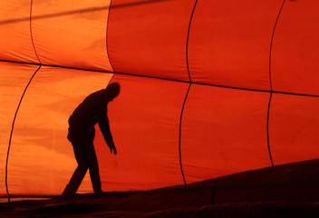 A hot air balloon is prepared for flight at the International Balloon Fiesta near Bristol in western England