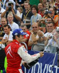 Loeb of France sprays champagne on fans after winning Catalunya Rally in Salou near Tarragona Spain