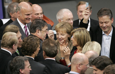 German Chancellor Merkel casts her vote for the budget 2008 during a session of the German lower house of parliament Bundestag in Berlin
