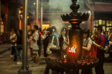 People praying and lighting incense at Longshan Temple in the center of the city