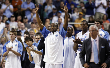 University of North Carolina forward Mike Copeland reacts as his team leads against Louisiana State University during the second round of their NCAA basketball game in Greensboro