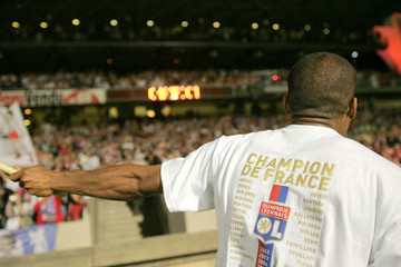 Florent Malouda of Olympique Lyon celebrates after winning the Champion of France for the sixth time running at the Gerland stadium in Lyon