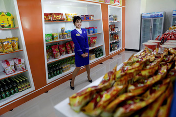 A vendor is pictured in a shop in a newly constructed residential complex after its opening ceremony in Ryomyong street in Pyongyang