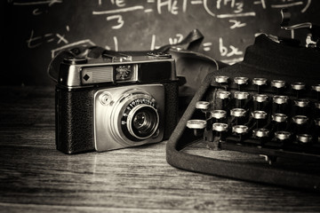 Old vintage retro camera with old-fashioned typewriter
