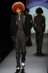 Models display creations by French designer Jean-Paul Gaultier as part of his Fall/Winter 2009/10 men's collections during Paris Fashion Week