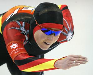 PECHSTEIN OF GERMANY SKATES TO GOLD IN OLYMPIC WOMENS 5000 M SPEEDSKATING.