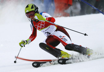 Nicole Hosp of Austria passes a pole during the first slalom leg of the women's Olympic combined at the Winter Olympic Games