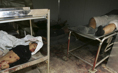 Body of an Iraqi girl lies inside a morgue with other victims after a roadside bomb attack in Amriya district in Baghdad