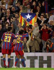Barcelona's Brazilian soccer player Ronaldinho and Oleguer celebrate the first goal against Malaga in Barcelona