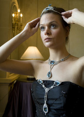 A model displays an aquamarine and diamond corsage ornament, necklace and tiara made in 1912 by Cartier during an auction preview at Sotheby's in Geneva