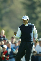 TIGER WOODS CELEBRATES A BIRDIE PUTT AT THE ACCENTURE WORLD GOLF CHAMPIONSHIP