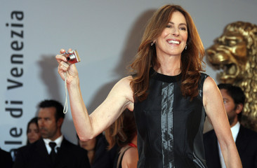 U.S. director Bigelow takes a picture during a red carpet event at the Venice Film Festival